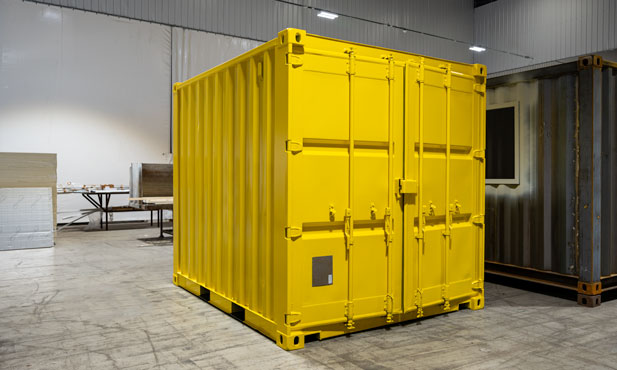 Spray painting shipping containers